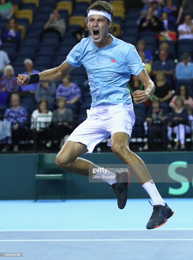 Jurabek Karimov of Uzbekistan celebrates match point against Cameron Norrie of Great Britain during day one of the Davis Cup match between Great Britain and Uzbekistan at Emirates Arena on September 14, 2018 in Glasgow, Scotland.