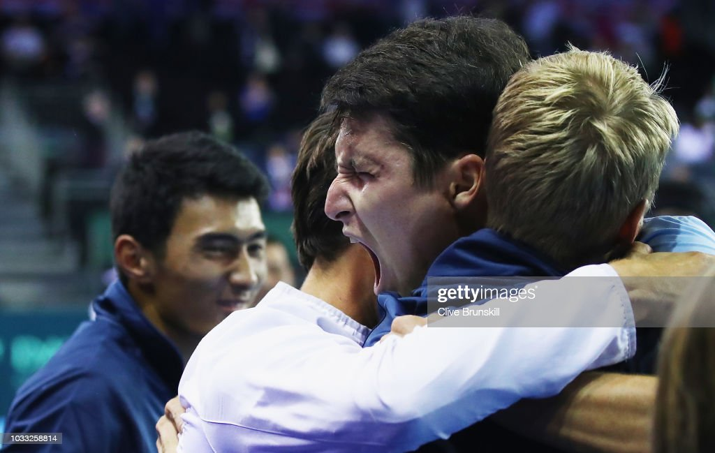 Jurabek Karimov of Uzbekistan celebrates with his team mates after his five set victory against Cameron Norrie of Great Britain during day one of the Davis Cup match between Great Britain and Uzbekistan at Emirates Arena on September 14, 2018 in Glasgow, Scotland.