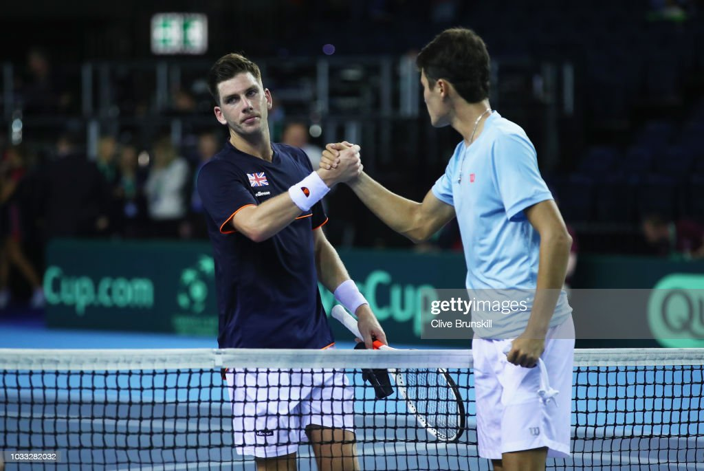 Jurabek Karimov of Uzbekistan shakes hands at the net after his five set victory against Cameron Norrie of Great Britain during day one of the Davis Cup match between Great Britain and Uzbekistan at Emirates Arena on September 14, 2018 in Glasgow, Scotland.