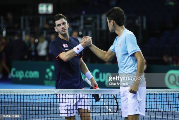 Jurabek Karimov of Uzbekistan shakes hands at the net after his five set victory against Cameron Norrie of Great Britain during day one of the Davis...