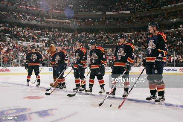Juraj Kolnik Gregory Campbell Stephen Weiss Steve Montador and Branislav Mezei of the Florida Panthers stand for the National Anthem before the game...