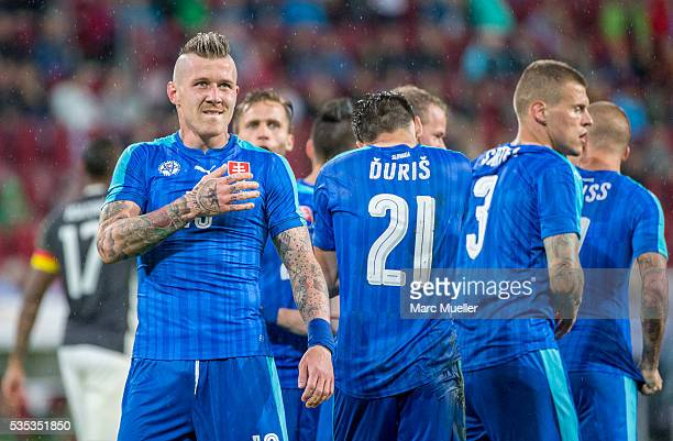 Juraj Kucka and his team celebrate after scoring third goal against Germany during the international friendly match between Germany and Slovakia at...