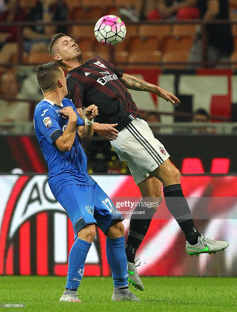 Juraj Kucka (R) of AC Milan competes for the ball with Piotr Zielinski (L) of Empoli FC during the Serie A match between AC Milan and Empoli FC at Stadio Giuseppe Meazza on August 29, 2015 in Milan, Italy.