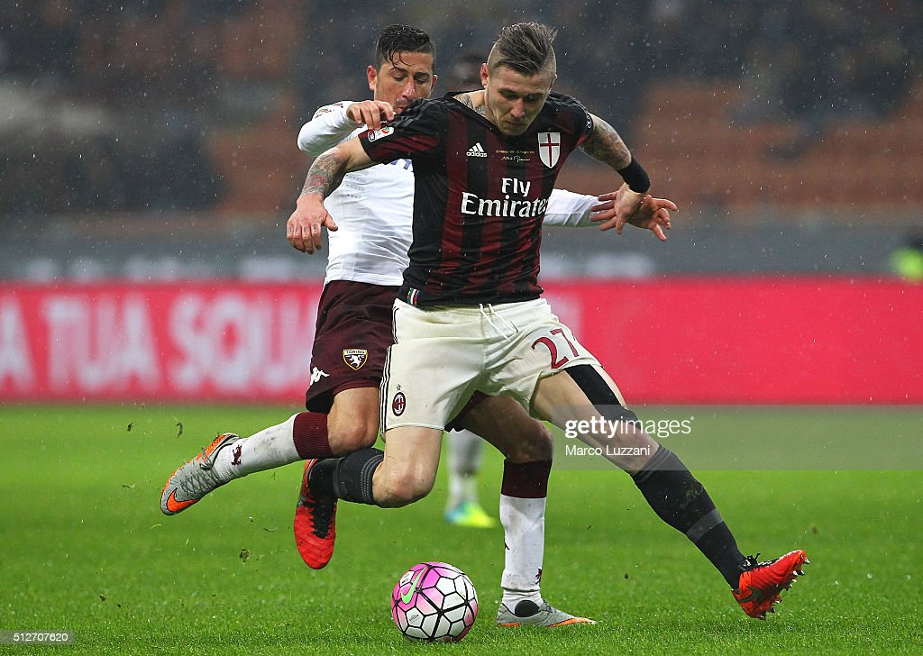 Juraj Kucka of AC Milan is challenged by Giuseppe Vives (back) of Torino FC during the Serie A match between AC Milan and Torino FC at Stadio Giuseppe Meazza on February 27, 2016 in Milan, Italy.
