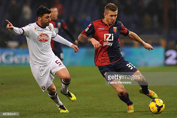 Juraj Kucka of Genoa CFC in action against Cesare Bovo of Torino FC during the Serie A match between Genoa CFC and Torino FC at Stadio Luigi Ferraris...