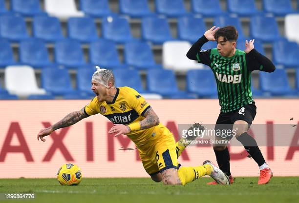 Juraj Kucka of Parma Calcio and Maxime Lopez of Sassuolo battle for the ball during the Serie A match between US Sassuolo and Parma Calcio at Mapei...