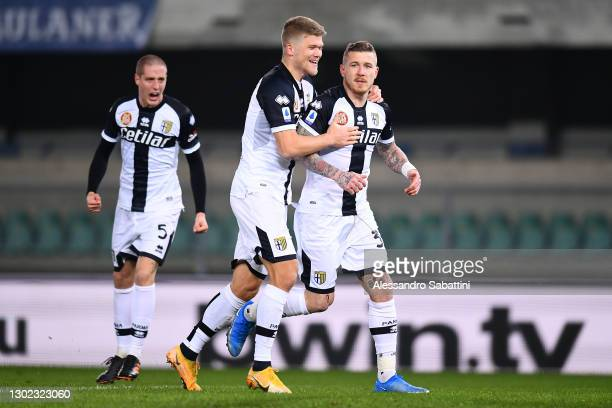 Juraj Kucka of Parma Calcio celebrates with teammate Andreas Cornelius after scoring their team's first goal during the Serie A match between Hellas...