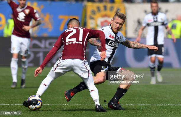 Juraj Kucka of Parma Calcio competes for the ball with Alejandro Berenguer of Torino FC during the Serie A match between Parma Calcio and Torino FC...