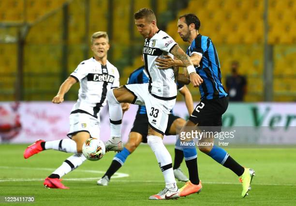 Juraj Kucka of Parma Calcio competes for the ball with Diego Godin of FC Internazionale during the Serie A match between Parma Calcio and FC...