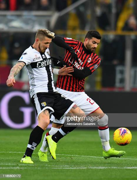 Juraj Kucka of Parma Calcio competes for the ball with Mateo Musacchio of AC Milan during the Serie A match between Parma Calcio and AC Milan at...