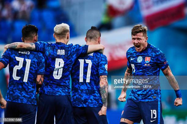 Juraj Kucka of Slovakia celebrates with team mates after the final whistle during the UEFA Euro 2020 Championship Group E match between Poland and...