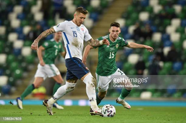 Juraj Kucka of Slovakia controls the ball under pressure from Jordan Thompson of Northern Ireland during the UEFA EURO 2020 Play-Off Final between...