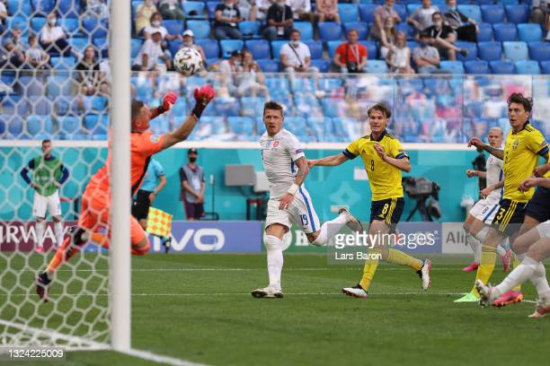 Juraj Kucka of Slovakia has a shot saved by Robin Olsen of Sweden during the UEFA Euro 2020 Championship Group E match between Sweden and Slovakia at...