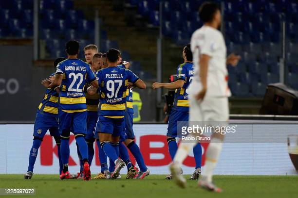 Juraj Kucka with his teammates of Parma Calcio celebrates after scoring the opening goal from penalty spot during the Serie A match between AS Roma...