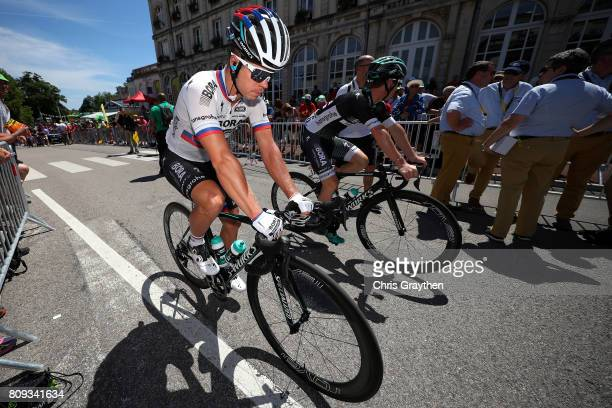 Juraj Sagan of Slovakia riding for Bora-Hansgrohe rides past UCI Commisares prior to stage five of the 2017 Le Tour de France, a 160.5km stage from...