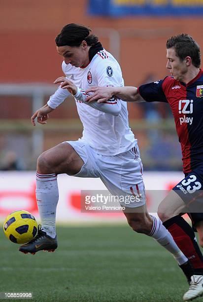 Juray Kucka of Genoa CFC competes with Zlatan Ibrahimovic of AC Milan during the Serie A match between Genoa CFC and AC Milan at Stadio Luigi...