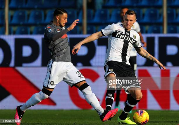 Juray Kucka of Parma Calcio battles for the ball with Rolando Mandragora of Udinese Calcio during the Serie A match between Parma Calcio and Udinese...