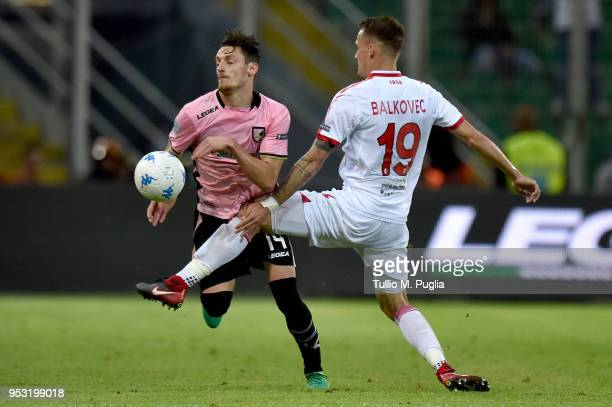 Jure Balkovec of Bari fouls Gabriele Rolando of Palermo during the serie A match between US Citta di Palermo and AS Bari at Stadio Renzo Barbera on...