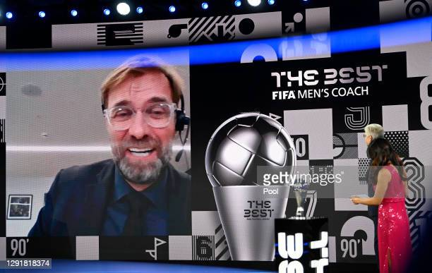 Juregen Klopp is seen giving a acceptance speech via video link after winning The Best FIFA Men's Coach award as Arsene Wenger and Reshmin Chowdhury...