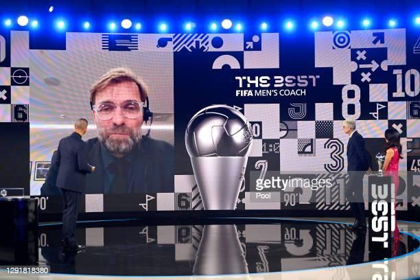 Juregen Klopp is seen giving a acceptance speech via video link after winning The Best FIFA Men's Coach award as Arsene Wenger and Reshmin Chowdhury...
