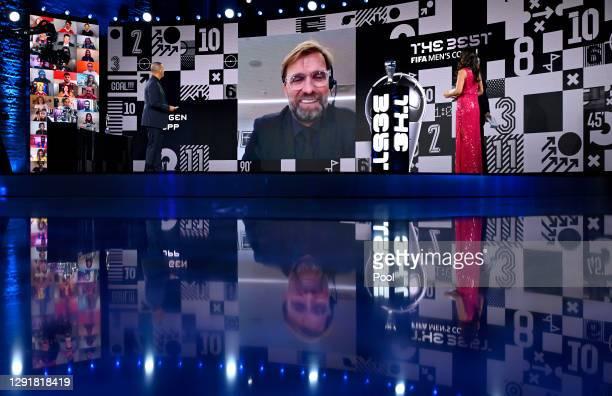 Juregen Klopp is seen giving a acceptance speech via video link after winning The Best FIFA Men's Coach award as Ruud Gullit, Arsene Wenger and...