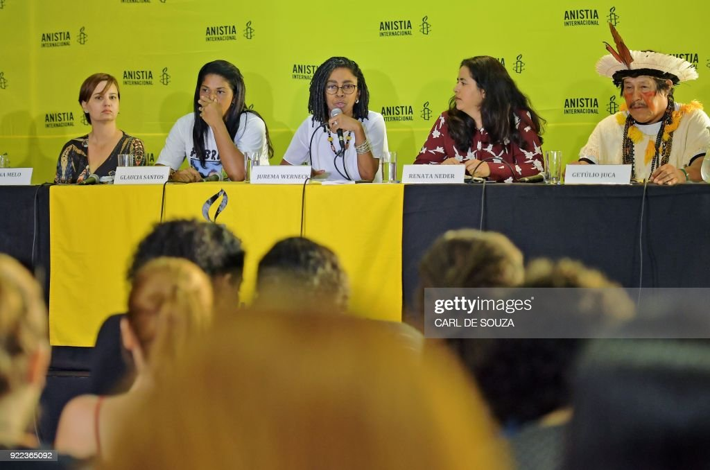 Jurema Werneck (C), head of human rights watchdog Amnesty International in Brazil, speaks during a press conference in Rio de Janeiro on February 21, 2018. Amnesty International is concerned about the Brazilian government's plans for military intervention to police Rio's poor favela neighborhoods. 'The intervention in Rio is an inadequate and extreme measure that is worrying because it puts the population's human rights at risk,' said Jurema Werneck, head of the rights group in Brazil. /