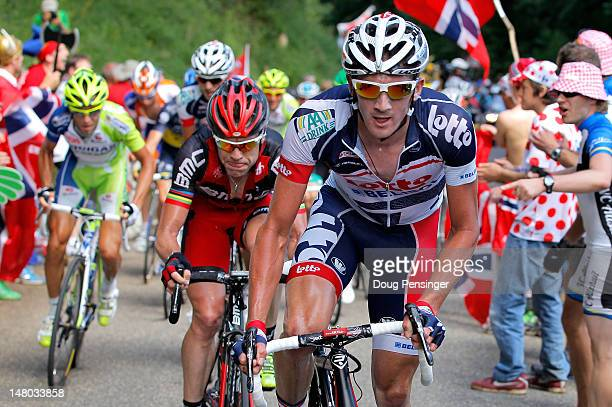 Jurge Van Den Broeck of Belgium riding for Lotto-Belisol attacks the group of the yellow jersey and is followed by Cadel Evans of Australia riding...