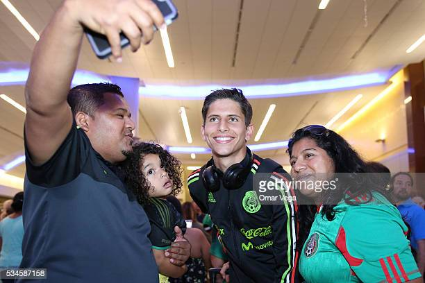 Jurgen Damm of Mexico poses for a picture with a fan during the Mexico National Team arrival to United States at HartsfieldJackson International...