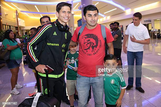 Jurgen Damm of Mexico poses for photos with a fan during the Mexico National Team arrival to United States at HartsfieldJackson International Airport...