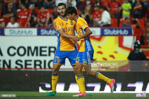 Jurgen Damm of Tigres celebrates with Andre Pierre Gignac after scoring the second goal of his team during the semi final second leg match between...