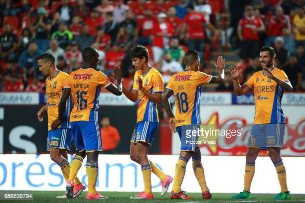 Jurgen Damm of Tigres celebrates with Luis Advincula after scoring the second goal of his team during the semi final second leg match between Tijuana...