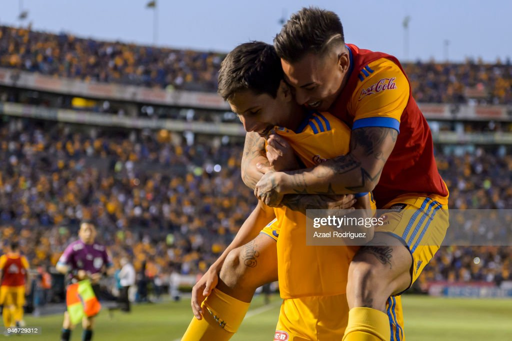 Jurgen Damm of Tigres celebrates with teammates after scoring his team's first goal during the 15th round match between Tigres UANL and Cruz Azul as part of the Torneo Clausura 2018 Liga MX at Universitario Stadium on April 14, 2018 in Monterrey, Mexico.