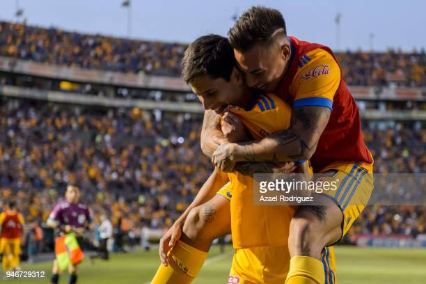 Jurgen Damm of Tigres celebrates with teammates after scoring his team's first goal during the 15th round match between Tigres UANL and Cruz Azul as...