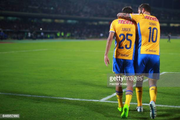 Jurgen Damm of Tigres celebrates with teammates after scoring the second goal of his team during the quarterfinals second leg match between Pumas...