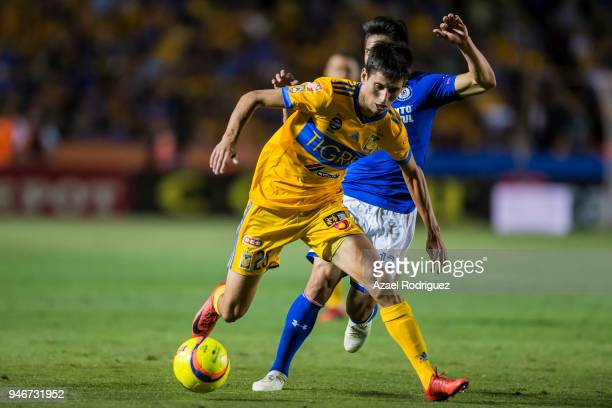 Jurgen Damm of Tigres fights for the ball with Angel Mena of Cruz Azul during the 15th round match between Tigres UANL and Cruz Azul as part of the...