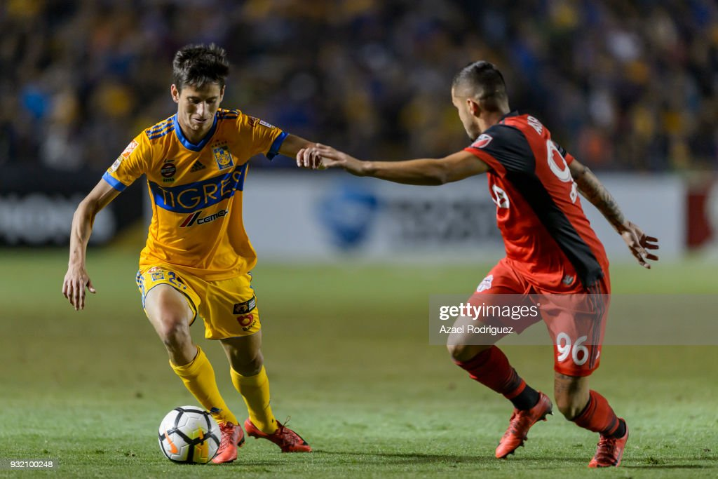Jurgen Damm of Tigres fights for the ball with Auro Junior of Toronto during the quarterfinals second leg match between Tigres UANL and Toronto FC as part of the CONCACAF Champions League 2018 at Universitario Stadium on March 13, 2018 in Monterrey, Mexico.