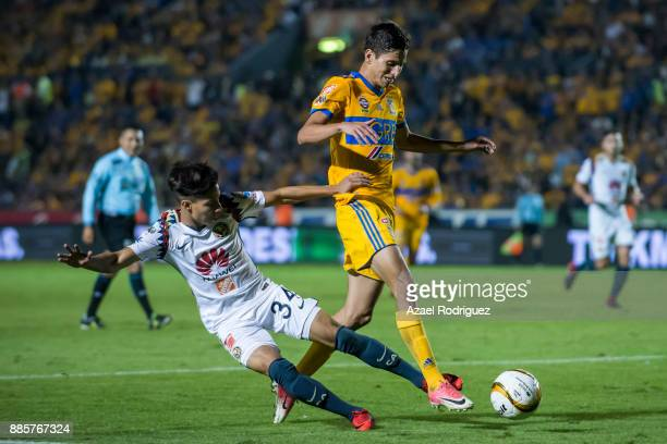 Jurgen Damm of Tigres fights for the ball with Diego Lainez of America during the semifinal second leg match between Tigres UANL and America as part...