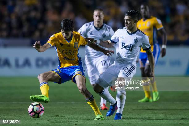 Jurgen Damm of Tigres fights for the ball with Fredy Montero of Vancouver Whitecaps during the semifinals first leg match between Tigres UANL and...