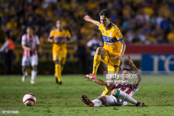 Jurgen Damm of Tigres fights for the ball with Igor Lichnovsky of Necaxa during the 16th round match between Tigres UANL and Necaxa as part of the...