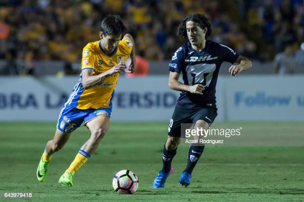 Jurgen Damm of Tigres fights for the ball with Matias Britos of Pumas during the quarterfinals first leg match between Tigres UANL and Pumas UNAM as...