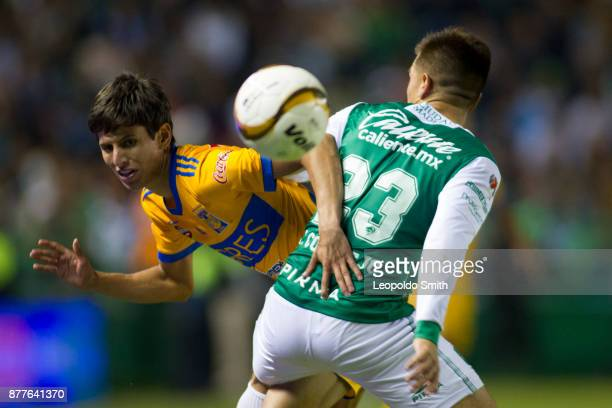 Jurgen Damm of Tigres figths for the ball with Juan Cornejo of Leon during the quarter finals first leg match between Leon and Tigres UANL as part of...