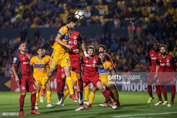 Jurgen Damm of Tigres heads the ball during the quarterfinals second leg match between Tigres UANL and Toronto FC as part of the CONCACAF Champions...