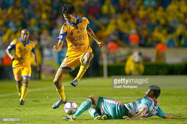 Jurgen Damm of Tigres jumps over Nestor Araujo of Santos during the 15th round match between Tigres UANL and Santos Laguna as part of the Apertura...