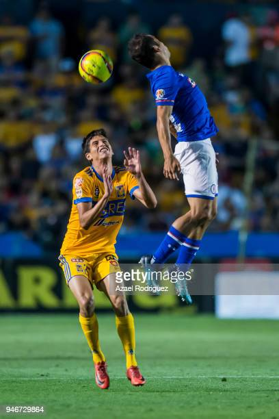 Jurgen Damm of Tigres observes as Julio Dominguez of Cruz Azul heads the ball during the 15th round match between Tigres UANL and Cruz Azul as part...