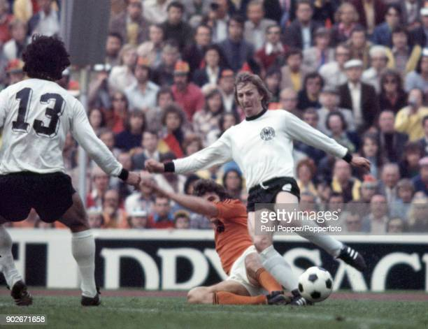 Jurgen Grabowski of West Germany is tackled by Dutch defender Wim Van Hanegem during the FIFA World Cup Final between West Germany and Holland at the...