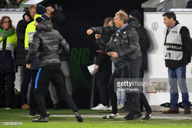 Jurgen Klinsmann Head Coach of Hertha BSC celebrates after his team's second goal during the Bundesliga match between VfL Wolfsburg and Hertha BSC at...
