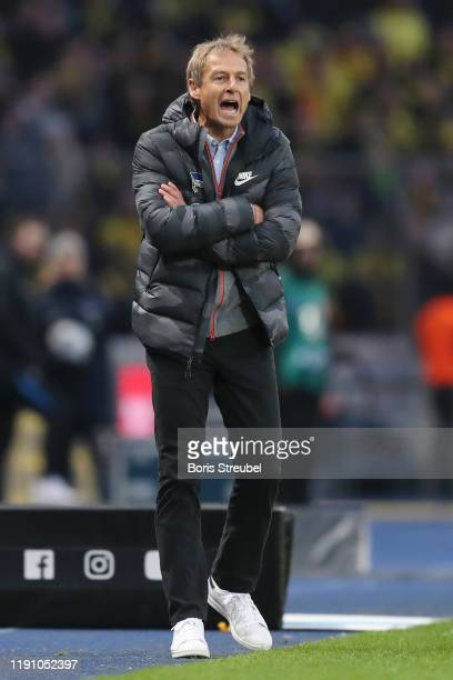 Jurgen Klinsmann Head Coach of Hertha BSC gives his team instructions during the Bundesliga match between Hertha BSC and Borussia Dortmund at...