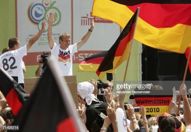 Jurgen Klinsmann , head coach of the German National Team, arrives at the Berlin Fan Mile at the Brandenburg Gate on July 9, 2006 in Berlin, Germany....