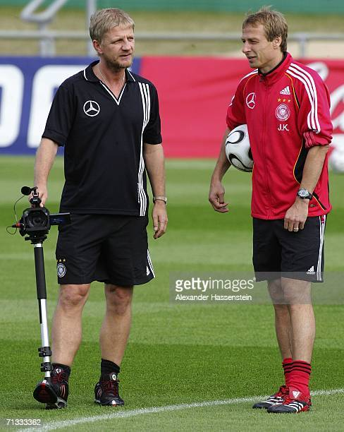 Jurgen Klinsmann head coach of the German National Team talks with Film Director and former professional soccer player Soenke Wortmann during the...