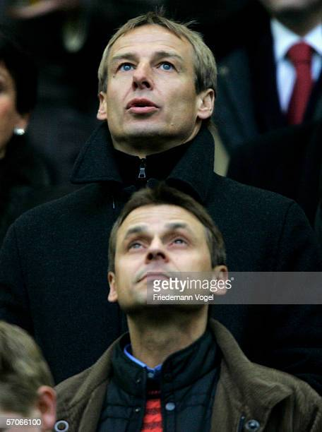 Jurgen Klinsmann, headcoach of the German National Team and Olaf Thon watches the Bundesliga match between FC Schalke 04 and Eintracht Frankfurt at...